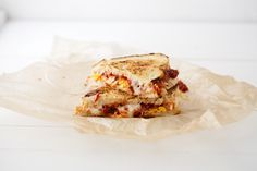 Roasted Tomato and Egg Grilled Cheese Sandwich.  A little naughty, but oh my, doesn't it look amazing?