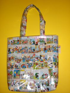 Eco Bag Made with Comics! Eco bag made with comics! in accessories with Recycled comics bag<br> I have made this bag with old comics and waste Fused Plastic, Recycled Plastic Bags, Recycled Magazines, Recycled Art, Plastic Spoons, Recycled Clothing, Recycled Fashion, Diy Recycling, Reuse Recycle