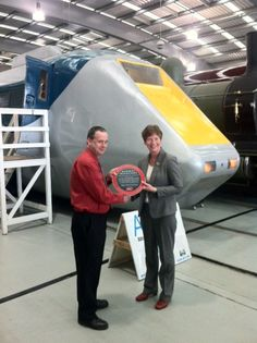 Advanced Passenger Train-Experimental (APT-E), May 2013. Paul Leadley, from the APT-E Conservation and Support Group is presented with the Engineering Heritage Award by Prof Isobel Pollock, Past President of the Institution of Mechanical Engineers.