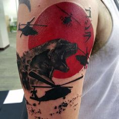Trash Polka Watercolor Tattoo Of Godzilla Fighting Helicopters On Man