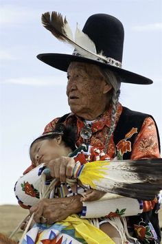 Crow Elder Newton Old Crow, with her little daughter, at Crow Fair on Crow…