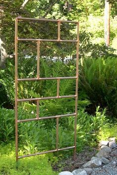 Trellis made from copper pipe.  (You could use other materials too) Dishfunctional Designs: The Upcycled Garden May 2013