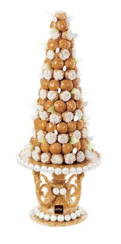La Croquembouche ~ French pièce montée made of pastry cream filled cream puffs, Profiteroles. It is the centerpiece of the French wedding buffet, and serves as the French wedding cake. #PieceMontee #ShaunaGiesbrecht #VonGiesbrechtJewels