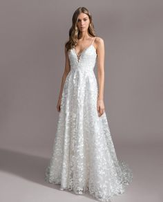 9facf536 Style 7950 Avery Ti Adora by Allison Webb bridal gown - Ivory floral  embroidered lace A-line gown. Sheer V-neckline and scoop back with jeweled  trim ...