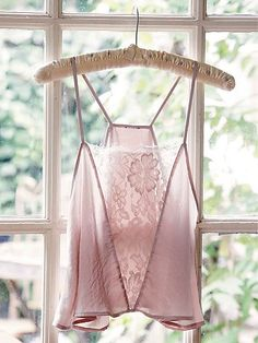 Jones Cami | Silky romantic cropped cami in a flowy silhouette. Features a beautiful sheer lace panel down the front, with eyelash lace trim. Open, flyaway back.