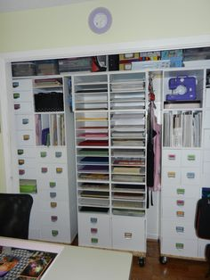 AMAZING Scrapbook closet made with 40 jetmax cubes, permanently connected and mounted on rolling bases.