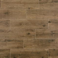 Mohawk ForeverStyle Oak Wood x Porcelain Wood Look Floor Tile (Common: x Actual: x at Lowe's. For those who want coordinating styles and everlasting durability, Mohawk offers a collection of wall and floor tiles that feature Porcelain Wood Tile, Ceramic Floor Tiles, Porcelain Floor, Mosaic Wall Tiles, Wall And Floor Tiles, Lowes Tile, Wood Look Tile, Wood Tiles, Tile Flooring