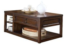 """The Kayden Lift-Top Coffee Table from Ashley Furniture HomeStore (AFHS.com). The """"Kayden"""" accent table collection takes warm rustic design and creates a collection that is both stylish and functional to better fit within the decor of any living room."""