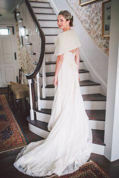 Elegant fall bride - strapless wedding dress accessorized with a fur shawl + bright red lip {Erik Kruthoff Photography}