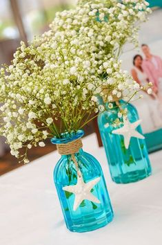 Beautiful beach themed centerpiece using blue mason jars, starfish and baby's breath. Perfect for a beach bridal shower or wedding. BABY'S BREATHS ONLY IDEA Beach Theme Centerpieces, Beach Wedding Decorations, Beach Wedding Favors, Wedding Themes, Wedding Ideas, Trendy Wedding, Beach Weddings, Wedding Blue, Centerpiece Ideas