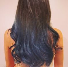 Back View of Highlighted Dark Brown Hairstyle with Waves