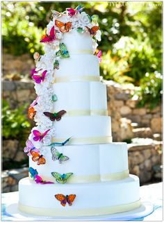 Cascading Colorful Butterflies Wedding Cake