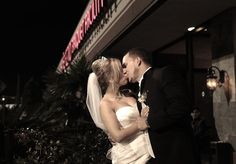 Bride and Groom first kiss at Pelazzio Wedding Venue in Houston, TX