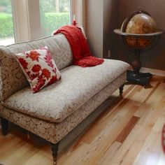 Pier 1 Platinum Gillian Loveseat accented with a Red Chenille Throw and Damask Applique Pillow