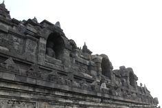 Borobudur temple with statues of Praying Gautama.