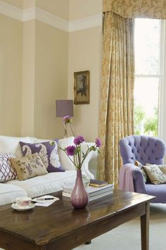 Exotic living room Use a richly coloured patterned wallpaper on a