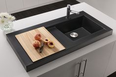 """BLANCO MODEX™ Irresistible from every angle. Rising 3"""" above the counter, this RED Dot Award winner elevates the kitchen workstation to new architectural standards. Features a large drainer board and a perfectly sized ash cutting board."""