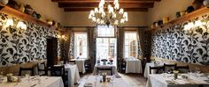 Helena's Restaurant, is located in two adjoining dining areas within Coopmanhuijs. The first area, beneath an antique yellow-wood ceiling, is appointed with richly embossed French wallpaper.