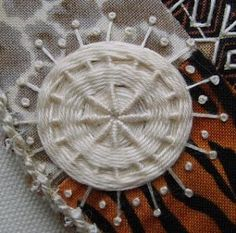 whipped and woven wheel (nice way to calm down a busy print, by embroidering white over it)