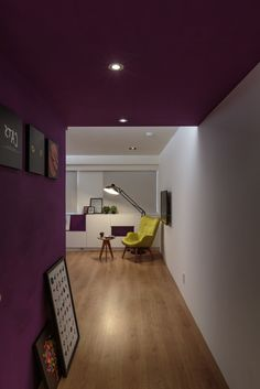 http://sandavy.com/inspiring-colorful-family-home-in-taiwan-inspiring-social-interaction-design/pretty-hallway-design-modern-interior-design-ideas-interior-decoration-ideas-led-tv-the-white-wall-floor-lamp-yellow-armchair-coffy-table-wooden-flooring-ceiling-lamp-picture-on-the-purple-wall/