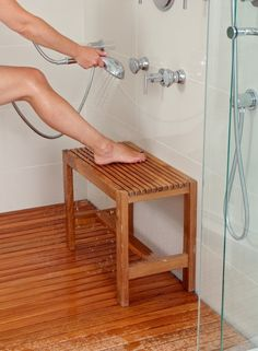 Teak shower stool, and floor mat!  Would love this in the master bath!