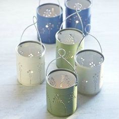 DIY Tin Can Lanterns - Recycle tin cans to make beautiful lanterns. (spray paint flowers tin cans) Recycled Tin Cans, Recycled Crafts, Recycled Tires, Recycled Clothing, Recycled Fashion, Craft Room Storage, Vintage Shelving, Tin Can Lanterns, Tin Can Lights