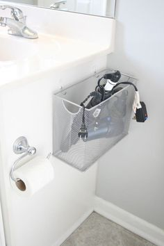 15-Minute DIY Bathroom Organization Ideas / File box for hairstyling tools.