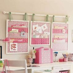 Love the idea-- get cute fabric and hang boards on rod with ribbon over desk area.  Can even be changed up.