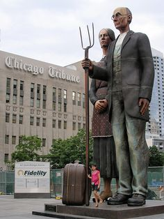 """J Seward Johnson's """"God Bless America,"""" an oversized sculpture of Grant Wood's painting """"American Gothic,"""" which can be seen at the nearby Art Institute of Chicago."""