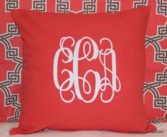 Coral custom sqaure pillow with white vine monogram!