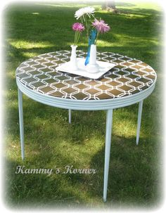Card Table Renewed!  Spray painted and recovered with a vinyl table cloth.