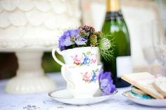 styled shoot: boho weddding inspiration I just love the idea of different kinds of old china being used as decorations--guest book table, etc.