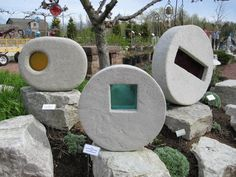 Concrete and Glass Sculpture Sculpture - Kim Wozniak  Oh. I have an idea. The plaster and peat and ?? Method to make light weight planters, with glass inserts. Awesome yard art. I don't have nearly enough projects going. Heh.