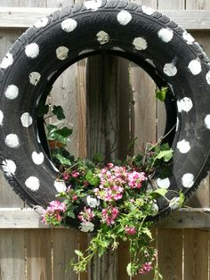 I really like the simplicity and creativity behind this project.  In reality, it's just an old tire that would have probably ended up in the dump.  However, with a little bit of paint, it was transformed into a flower pot that actually looks very adorable!