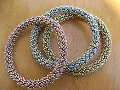 Spiral Superduo Bracelet.   made up as bangles in topaz and fuschia.. all my…