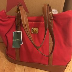 ❤️VDAY SALE❤️Ralph Lauren Tote!AUTHENTIC Ralph Lauren Cloth Bag, this would work perfect as an everyday work bag, diaper bag or travel bag. NWT, it's a pretty red with brown straps and bottom with plenty of space.  Ralph Lauren Bags Shoulder Bags