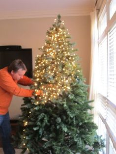 How to Light Your Tree Like a Pro - lots of pics showing how to string lights on the tree. #decoratingachristmastree
