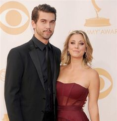 Kaley Cuoco and Ryan Sweeting arrive at the Emmy Awards on Sept. 22, 2013, in Los Angeles.