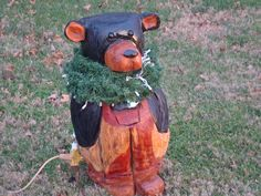 Bear carved out of red cedar - painted.  sold