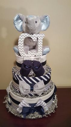 Elephant diaper cake,  navy and grey,  baby shower centerpiece gift.  Check out my Facebook page Simply Showers for more pics and orders.  https://m.facebook.com/adorablegifts