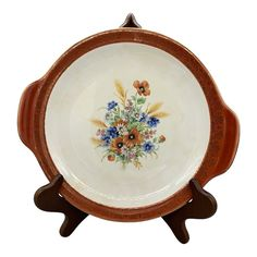 Salem China's Aristocratic Maroon Cake Plate Placed on Salem's Century coupe shape this pattern includes a colorful bouquet in the center and gold scroll around the edges. Oversized Wall Mirrors, Dessert Aux Fruits, Cereal Bowls, Cake Plates, Salad Plates, Dinner Plates, Cup And Saucer, Vintage Antiques, Dinnerware