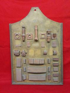 Catawiki, pagina di aste on line  Antico campionario La Rotta di prodotti in terracotta su espositore in legno