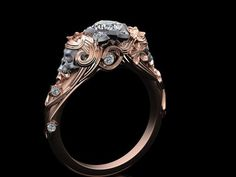This wonderful skull ring features a lovely Lady with flowing hair and flowers. The skull is in 14K white gold that is brushed finished. The