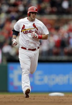 St. Louis Cardinals' Matt Adams rounds the bases after hitting a three-run home run during the third inning of a baseball game against t...