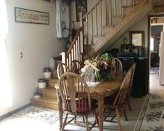 Dining room with oak staircase and depression glass galore!, This is ...