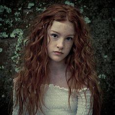 Love the pale skin, dark brown eyes, long red hair,...and top too:)