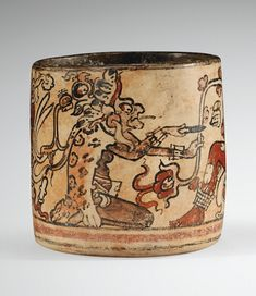 Vase with painted Underworld figures, including an old Smoking God (note the cigarette and smoke wisps). Southern Mexico or Guatemala, 600-900 AD.