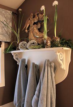 I like the idea of a shelf with hooks for towels
