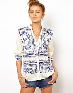 Blue patterned shirt.