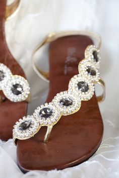 Side-winding jeweled sandals
